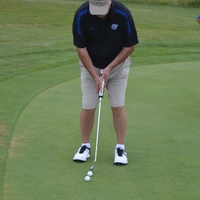 An alumnus golfing on The Meadows Golf Course.